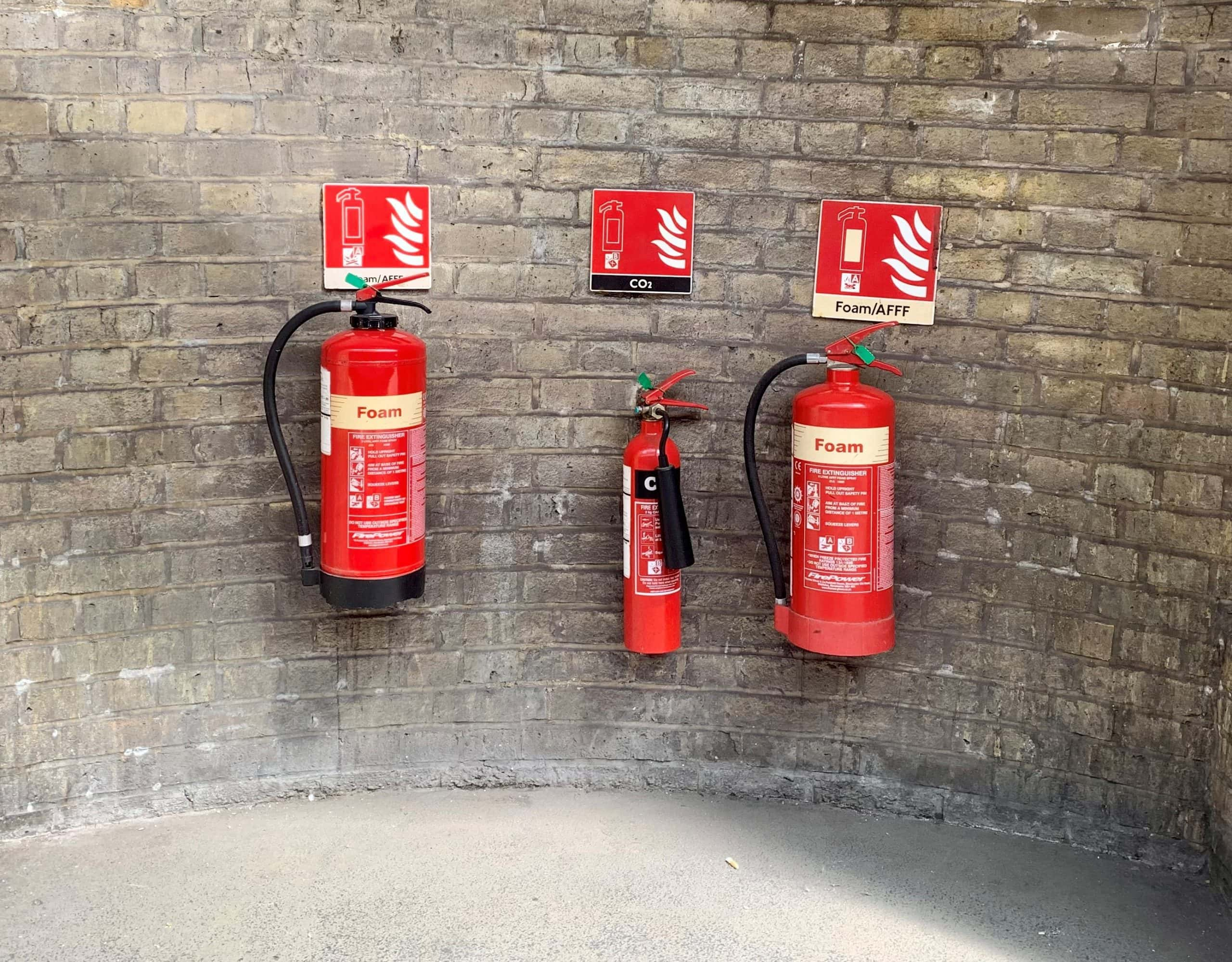 """Fire extinguishers featured in James Geary's """"I is Another: Secret Life of Metaphor"""" in the Examined Life Library."""